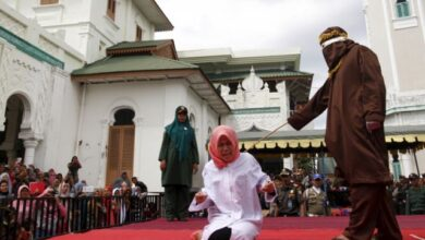 "Photo of Indonesia: Unmarried Couple publicly caned for being ""too close"""