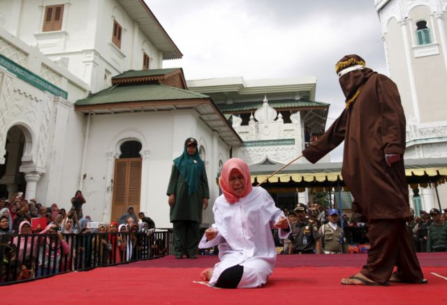 "UnmarriedCouplepubliclycanedforbeingtooclose - Indonesia: Unmarried Couple publicly caned for being ""too close"""