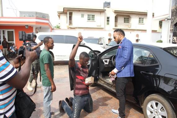 EMoneykceehawker - Kcee aka 'EMoney' gives away brand new car and cash gift to street hawker +Photos