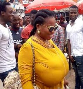 Photo of Men following this woman because of her huge breast... Instagram in real life!
